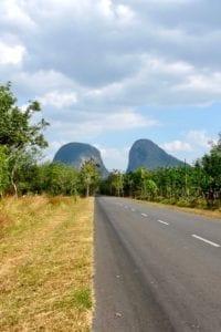 Perlis road approaching twin limestone hills | Malaysia