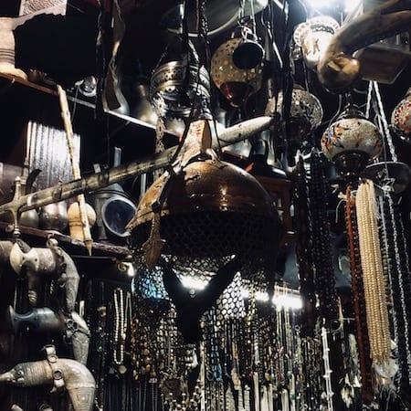 Military helmet | antiques in Mutrah souk | Oman shopping | Mutrah souq | old Muscat bazaar | Omani medieval market | Muscat tour | Oman tourism