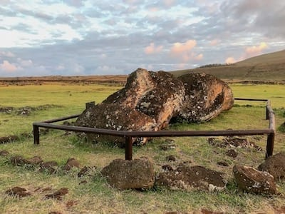 A fallen moai lying face up in the compound of Tongariki, Rapa Nui National Park | Easter Island heads